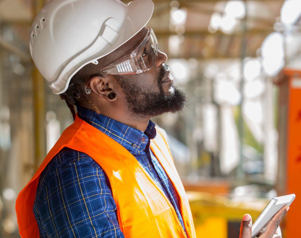 man wearing osha mandated ppe on the job