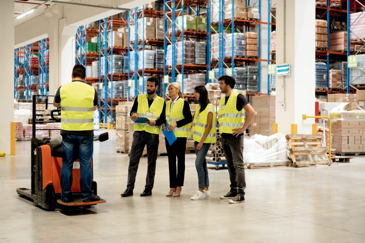 Employees in safety vests receiving safety training according to OSHA regulations