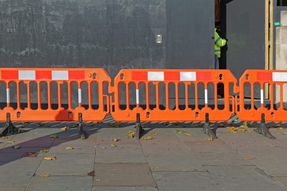 securing a construction site with barricades and locked doors