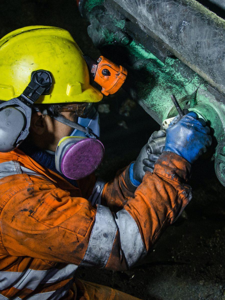 mine mechanic wearing a respirator
