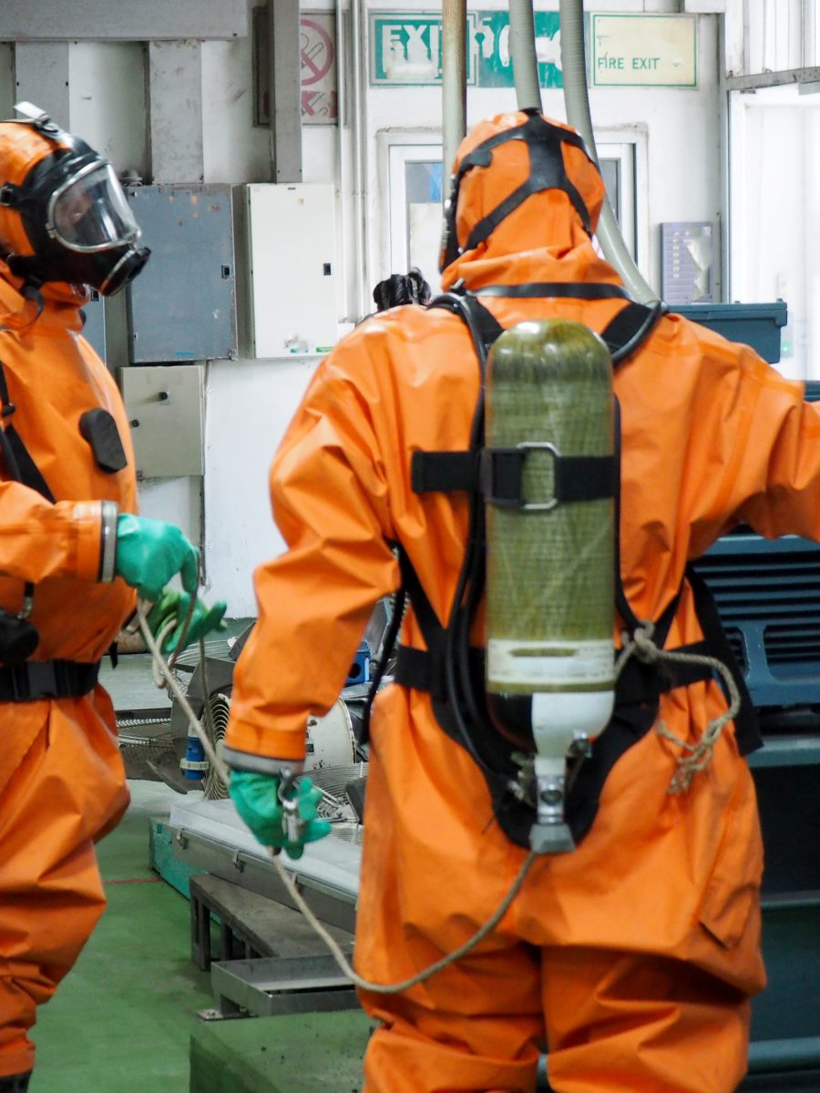 Two firefighters use their OSHA HAZWOPER training in a practice drill