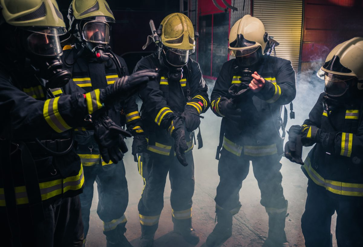 Team Of Firefighters In The Fire Department Wearing Gas Masks And Uniform