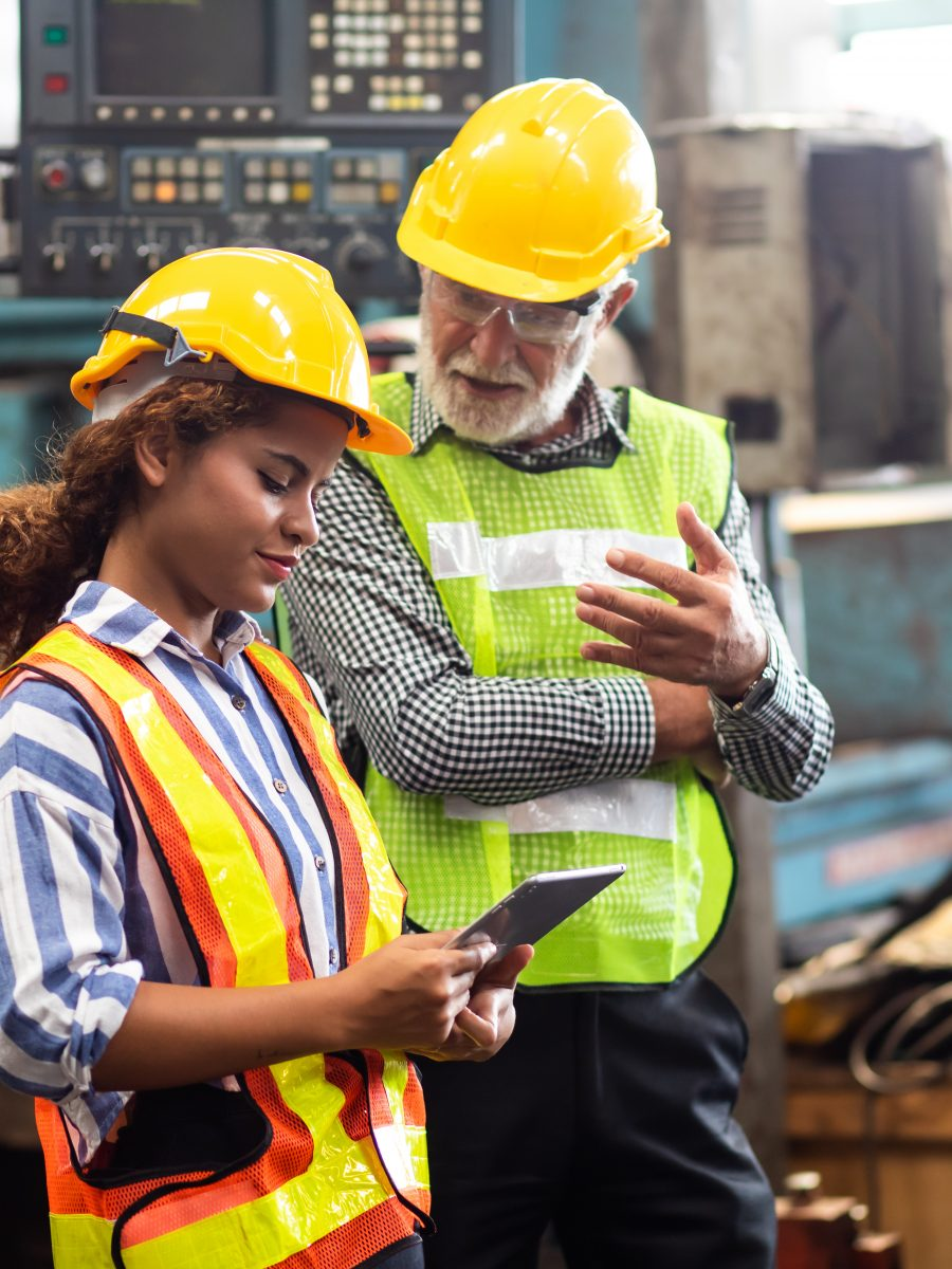 Two workers recording behavior based safety observations
