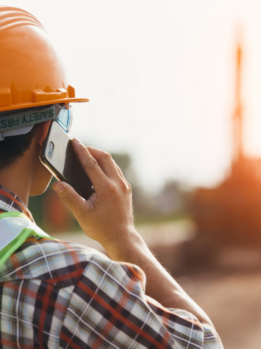 Construction worker calling 811 during excavation safety planning