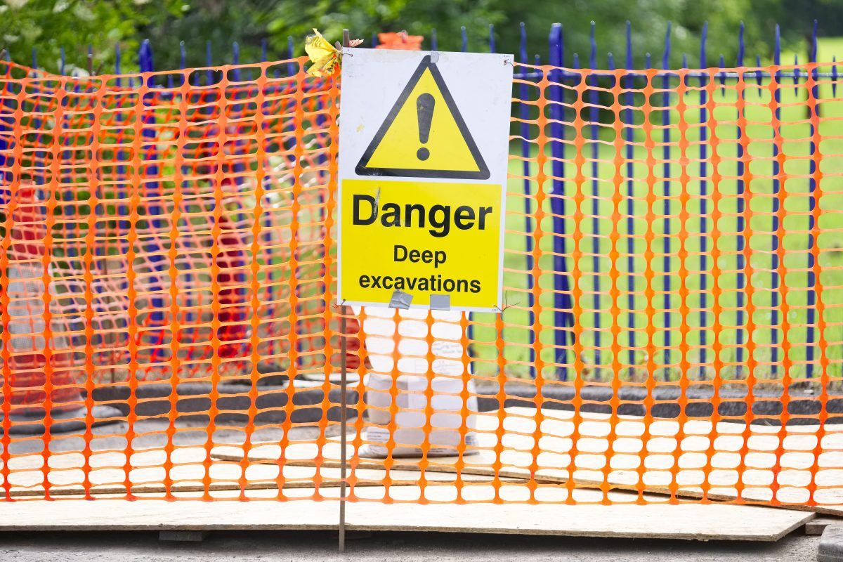 Danger Deep Excavation Sign And Orange Net Security