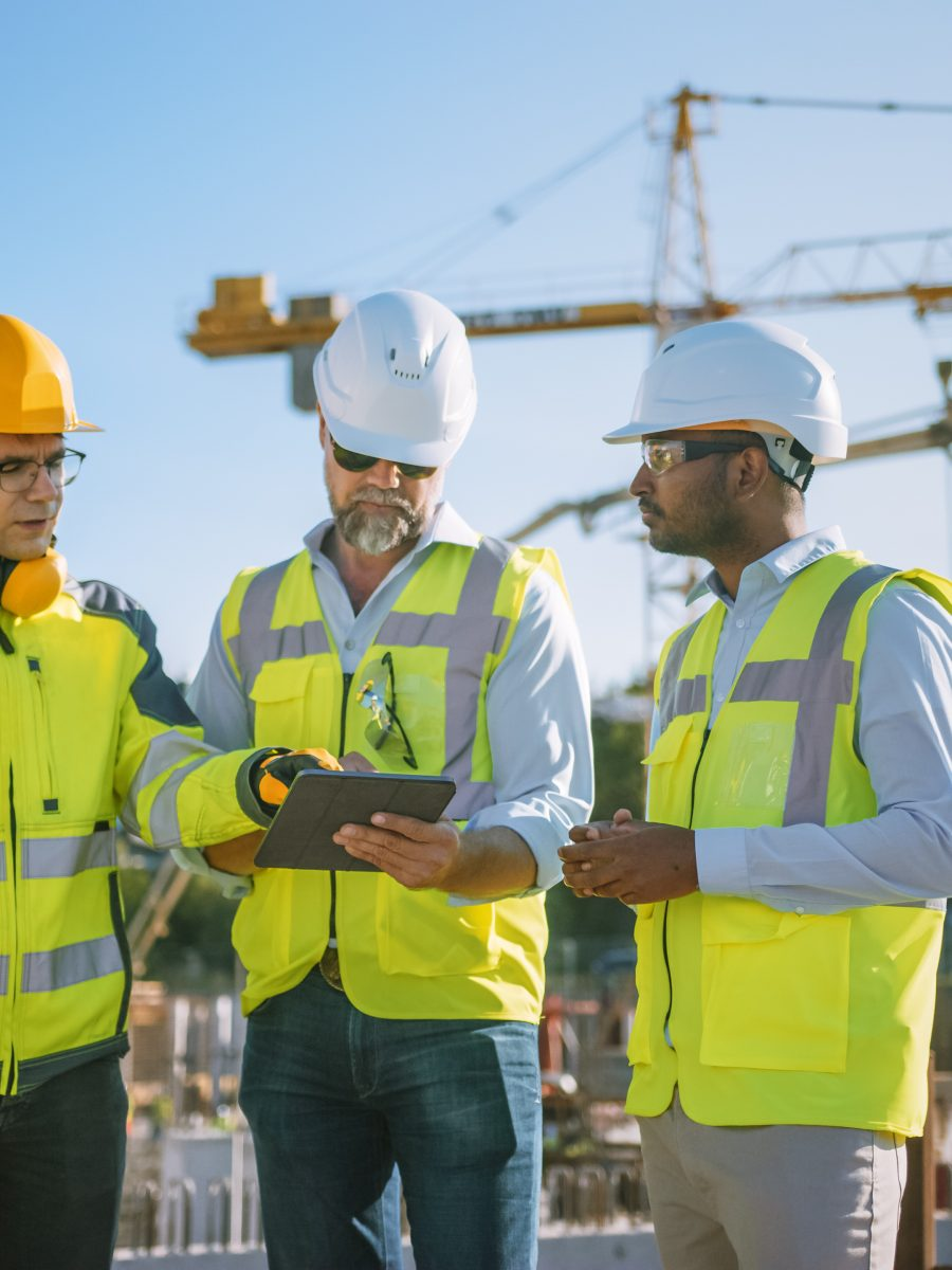 Construction team using safety management app on a tablet