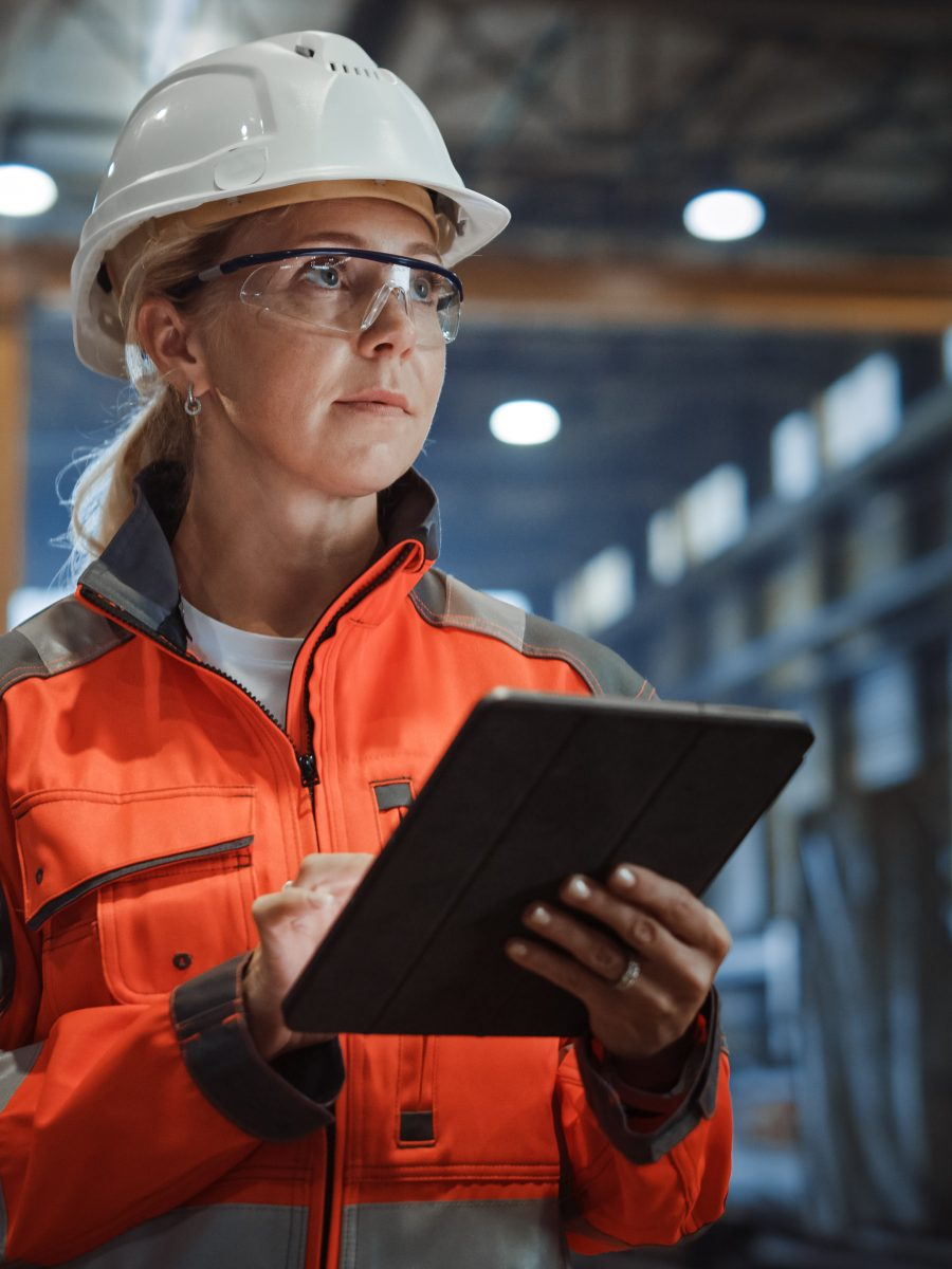 Woman runs safety software on the job