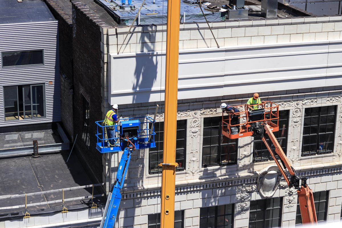 Workers At Work On Site